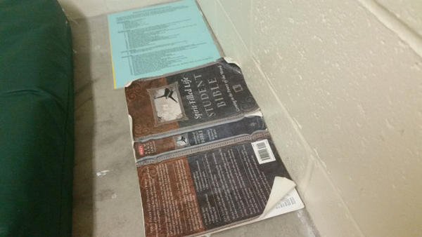 <p>Detainees told the report author that the only reading matter allowed in cells was a bible.</p>