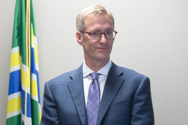 <p>Mayor Ted Wheeler stands next to the podium during a press conference with Portland Police Chief Danielle Outlaw.</p>