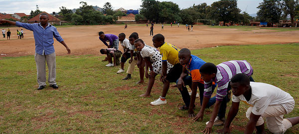 Children, part of the Young African Refugees for Integral Development program, get ready to play soccer.
