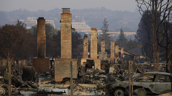 A row of chimneys stand in a neighborhood devastated by a wildfire on Oct. 13, 2017, near Santa Rosa, Calif. Massive wildfires swept through Northern California two months ago, destroying thousands of homes and businesses.
