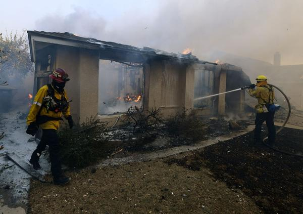 Firefighters try to save a house during the Thomas Fire in Ventura, Calif. on Dec. 5, 2017. (Mark Ralston/AFP/Getty Images)