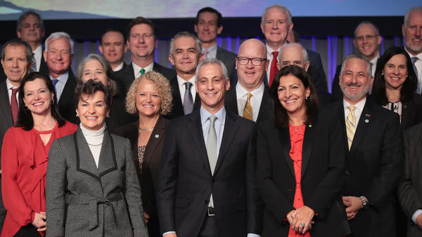 "Chicago Mayor Rahm Emanuel, (center) with other mayors from the U.S., Mexico and Canada at the summit, says, ""There is an absence of leadership out of Washington"" on climate change."