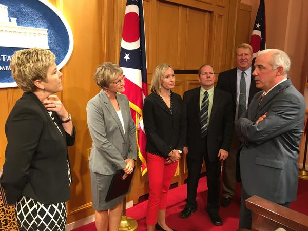 Sen. Matt Huffman (R-Lima, right) talks to a group of superintendents from his Senate district in western Ohio who helped him create the Public School Deregulation Act. They joined him for a press conference announcing the bill a few minutes earlier.