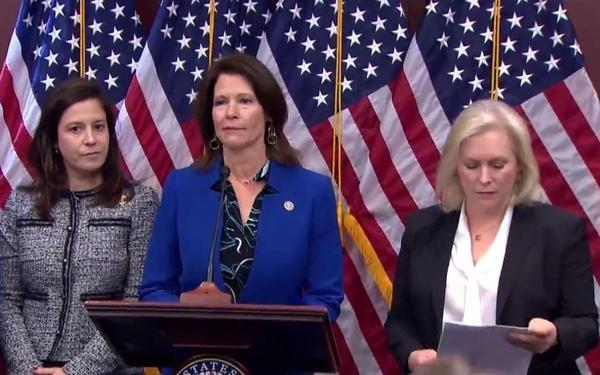 Democratic U.S. Rep. Cheri Bustos of Illinois is flanked by Republican U.S. Rep. Elise Stefanik of New York, left, and Democratic U.S. Sen. Kirsten Gillibrand of New York at a news conference Wednesday in Washington, D.C.