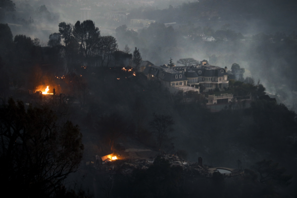 A mansion that survived a wildfire sits on a hilltop in the Bel Air district of Los Angeles after a dangerous new wildfire erupted in the area and across Southern California.