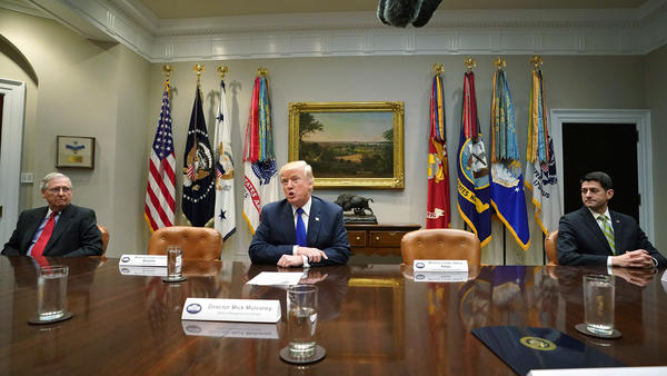 President Trump appears during what was supposed to be a meeting with bipartisan congressional leadership on Nov. 28. Democratic leaders Sen. Charles Schumer, D-N.Y., and Rep. Nancy Pelosi, D-Calif., skipped the meeting, and empty chairs were displayed to reinforce their absence.