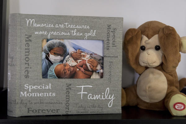 A photograph of Shalon with newborn daughter Soleil and mother Wanda is displayed on a shelf in Shalon's home next to the stuffed monkey that was given to Soleil in the hospital after she was born.