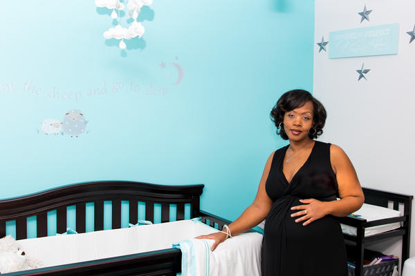 Shalon posed in the nursery while pregnant with Soleil.