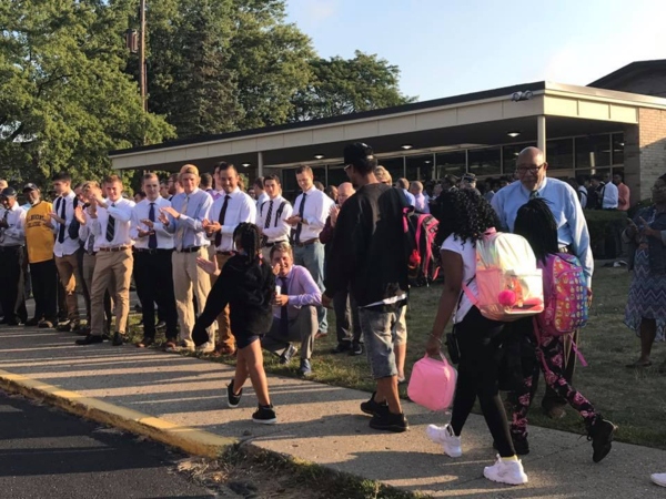 Harrington students are greeted by community members on the first day of school.