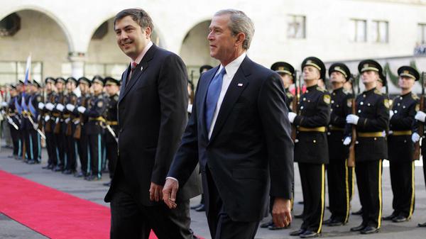 Mikhail Saakashvili, then Georgia's president, walks with President W. Bush during the latter's visit to Tbilisi in 2005.