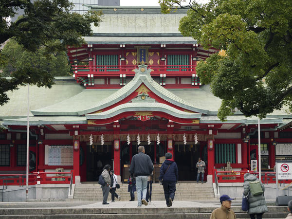 People visit Tomioka Hachimangu shrine in Tokyo on Friday, the day after police say three people were killed in a stabbing attack.