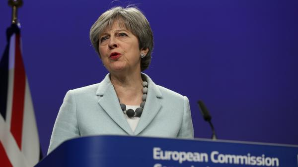 British Prime Minister Theresa May speaks during a joint news conference with European Commission Chief Jean-Claude Juncker in Brussels, Belgium on Friday.