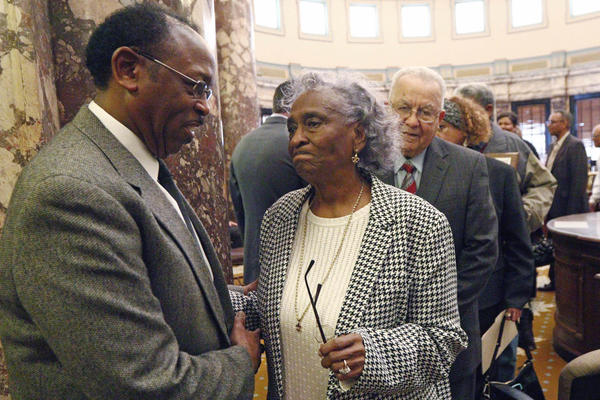 State Sen. Albert Butler Sr. speaks with Ellie Dahmer, the widow of NAACP leader Vernon Dahmer, who died when the Ku Klux Klan firebombed their home in 1966.