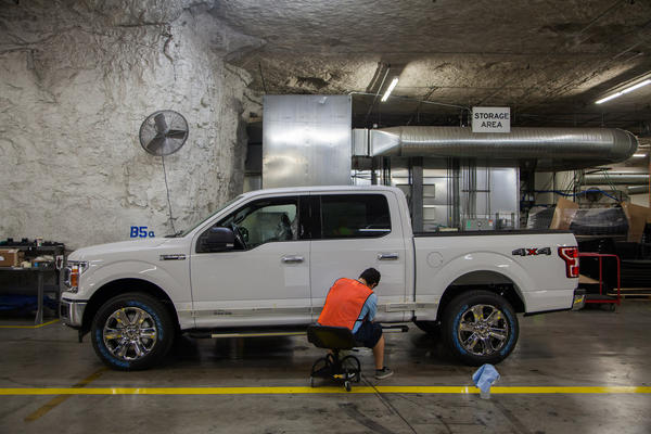 """Automotive Alley"" in SubTropolis, where Ford Transit cargo vans and F-150 trucks are painted and upfitted for commercial sale. (Dean Russell/Here & Now)"