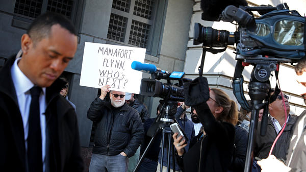 Protesters outside the federal courthouse where Michael Flynn pleaded guilty early this month speculate what is coming next in the special counsel probe.