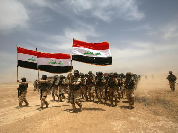 Thousands of Iraqi soldiers in Baghdad take part in a training exercise in 2015. On Saturday, the Iraqi prime minister announced its war on the Islamic State group was over, after more than three years of fighting.