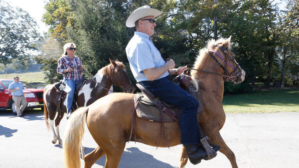 Alabama Republican Senate candidate Roy Moore and his wife, Kayla, ride their horses to vote in the GOP primary runoff earlier this year.