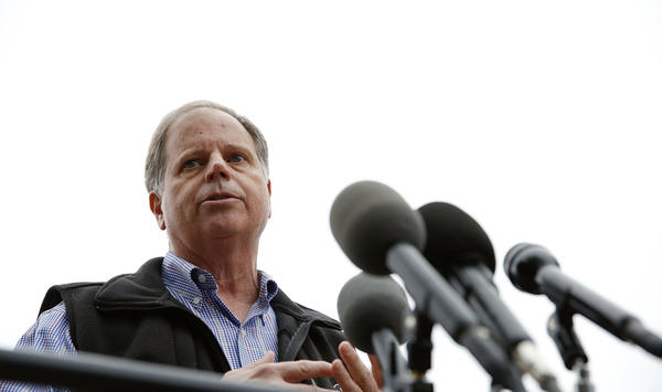 Democratic senatorial candidate Doug Jones speaks at a news conference in Dolomite, Ala., on Dec. 4.