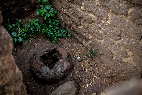 This is likely a pit toilet. The idea is that there's a giant hole underneath the toilet. It's from Revben and Havenes Banda's home in a rural village in Malawi. They live with their five children and five grandchildren; their monthly income is $50.