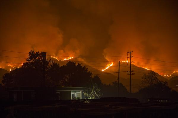 The growing Thomas Fire advances toward Santa Barbara County seaside communities on Dec. 10, 2017 in Carpinteria, Calif. (David McNew/Getty Images)