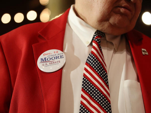 A supporter of Republican senatorial candidate Roy Moore attends a campaign rally at Oak Hollow Farm in Fairhope, Ala., on Dec. 5. Moore faces Democrat Doug Jones on Tuesday.