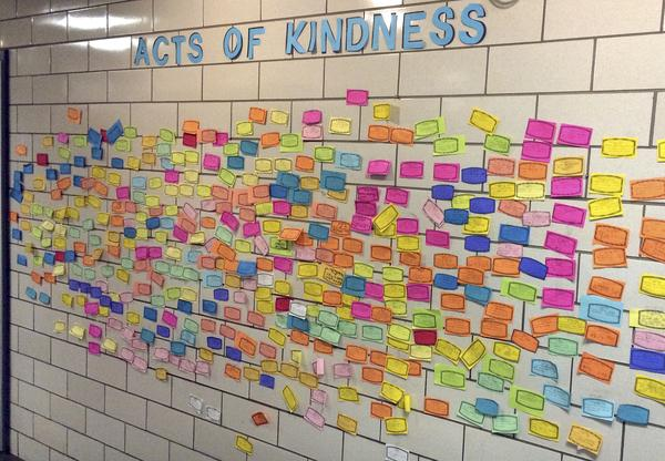 Slips of paper listing acts of kindness adorn the wall of the Pleasant Valley Elementary School in South Windsor, Conn., in 2015. The school asked children to perform 26 acts of kindness on the third anniversary of the Sandy Hook shooting.