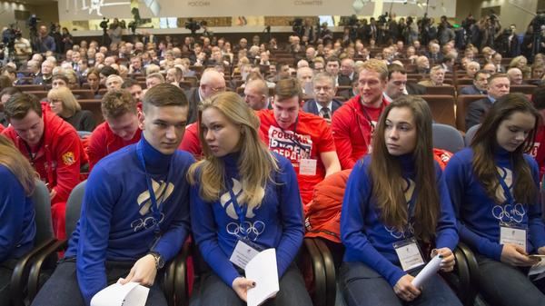 "Russian short track athletes, first row, and ice hockey players wearing sweatshirts with the words ""Russia is in my heart"" attend a Russian Olympic Committee meeting  Tuesday. The Russian committee said it will support athletes who compete at the 2018 Winter Games despite a ban on the national team."