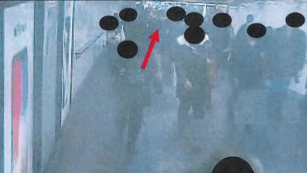 A red arrow points to Akayed Ullah, accused of triggering an explosion in the New York City subway system Monday. The image is from surveillance cameras in the commuter tunnel near Times Square; it's part of the federal complaint against Ullah.
