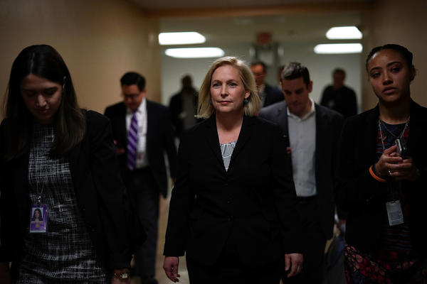 New York Democratic Sen. Kirsten Gillibrand (center) leaves after a Tuesday news conference on Capitol Hill.