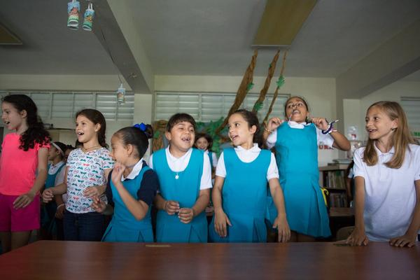 Children in the mountain town of Orocovis returned to school two weeks ago after a two-month pause following Hurricane Maria. The school doesn't have electricity, so it lets out at 12:30 pm.