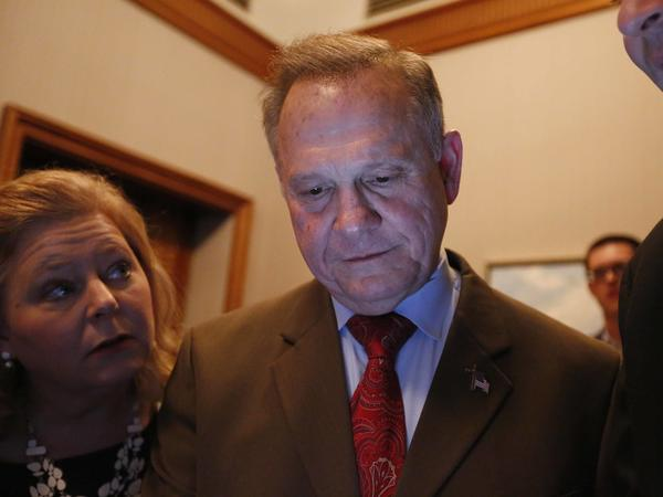 Republican Senate candidate Roy Moore looks at election returns with staff in Montgomery, Ala., on Tuesday night.