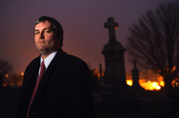 "Brett Talley stands in Holy Rood Cemetery in Washington, D.C., in 2014. Talley had been rated ""unanimously unqualified"" for a lifetime judicial appointment and his nomination ""will not be moving forward,"" according to a Trump administration official."