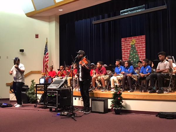 Kev Marcus and Will B of Black Violin, perform with Bethune Elementary students Tuesday in Hollywood.