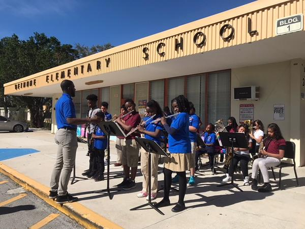 "Third, fourth and fifth graders in Mr. Leroy's concert band class play ""Jingle Bells"" to welcome Black Violin to Bethune Elementary School."