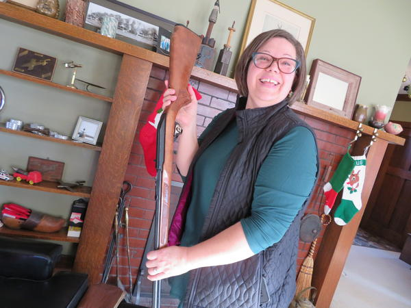 Holli Connell shows off the .22-caliber rifle she inherited from her father, who died unexpectedly from surgery complications a few years ago.