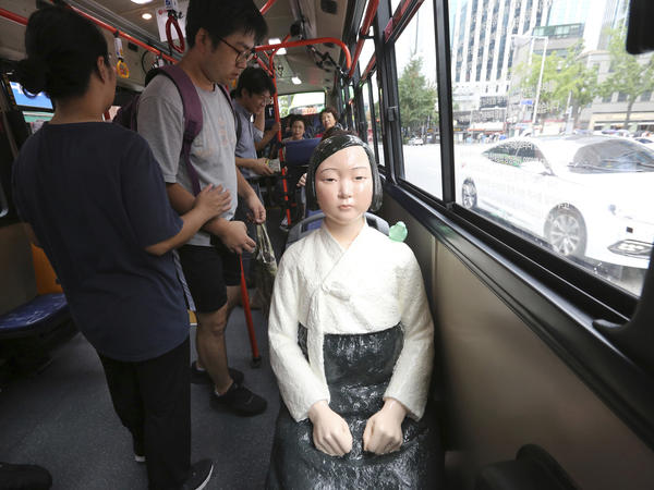 "A ""comfort woman"" statue is placed on a bus seat to mark the 5th International Memorial Day for Comfort Women in Seoul in August."