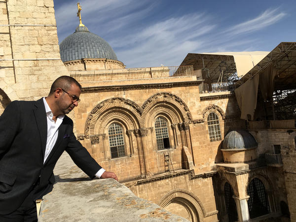 Dmitri Diliani, a Palestinian member of the Greek Orthodox church, stands on the roof of the Greek Orthodox Patriarchate of Jerusalem overlooking the Church of the Holy Sepulcher, which houses the traditional tomb of Jesus.