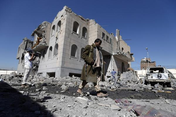 Yemenis check the site of airstrikes at a Houthi-run detention center in the capital Sanaa on Dec. 13, 2017. (Mohammed Huwais/AFP/Getty Images)