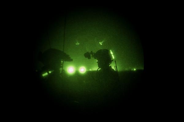 Members of the United States Army Special Forces, also known as the Green Berets, look through night vision goggles during a training of Afghanistan Special Forces on Sept. 10, in Helmand province, Afghanistan.