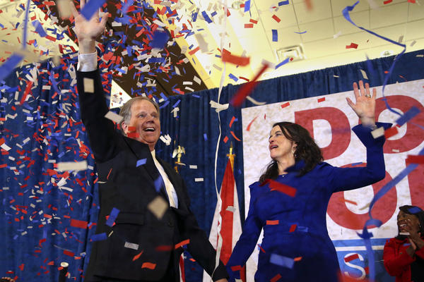 Democratic candidate for U.S. Senate Doug Jones and his wife Louise wave to supporters before speaking Tuesday, Dec. 12, 2017, in Birmingham, Ala. Jones has defeated Republican Roy Moore, a one-time GOP pariah who was embraced by the Republican Party and the president even after facing allegations of sexual impropriety. (AP Photo/John Bazemore)