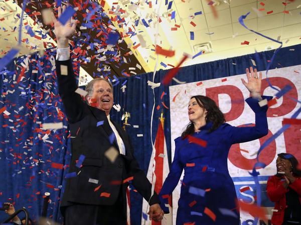 Democratic candidate for U.S. Senate Doug Jones and his wife Louise wave to supporters before speaking Tuesday, Dec. 12, 2017, in Birmingham, Ala. Jones has defeated Republican Roy Moore, a one-time GOP pariah who was embraced by the Republican Party and the president even after facing allegations of sexual impropriety. (John Bazemore/AP)