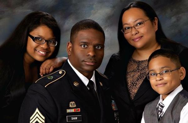 Shaw is surrounded by his family. From left, daughter Sarah, wife Valerie and son Tyree.