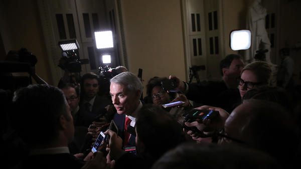 Senate Finance Committee member Sen. Rob Portman, R-Ohio, discusses progress on the GOP tax bill with reporters at the Capitol on Friday.