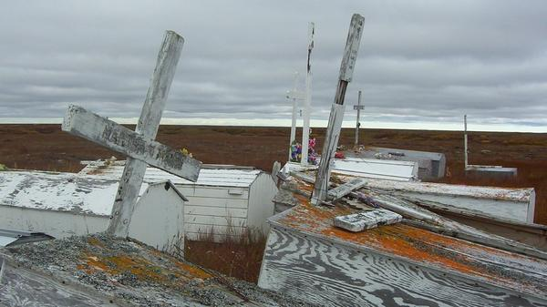 As the permafrost thaws, Kongiganak's cemetery is turning into swampland. Community members are now laying their loved ones to rest on raised platforms above the ground.