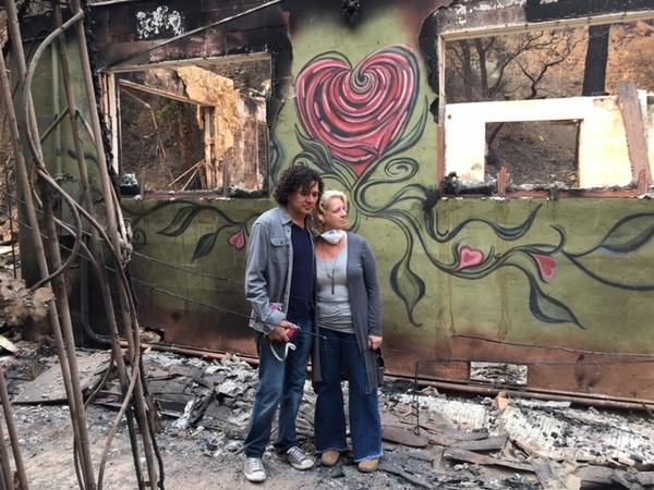 Dana and Dawn Ceniceros stand amid the rubble of what is left of their Ojai, Calif., home after the Thomas Fire ripped through the Matilija Canyon. The fire is one of the largest in the state's history. The Ceniceros have not joined in a lawsuit filed by other residents claiming utility companies are to blame.