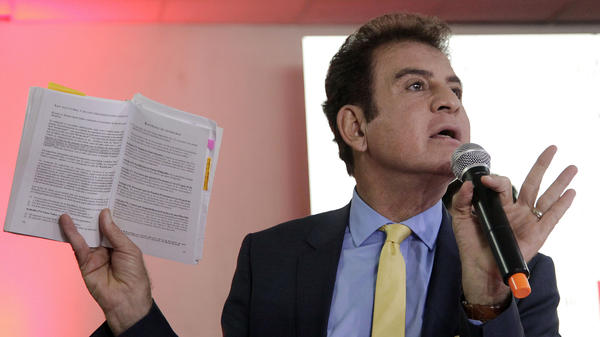 Salvador Nasralla, presidential candidate of the opposition alliance, gives a news conference in Tegucigalpa, Honduras, on Monday Dec. 11.