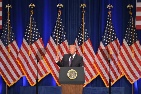 President Trump discusses his national security strategy in a speech on Monday. Trump's strategy is built around four pillars: protecting the homeland, promoting prosperity, peace through strength, and advancing American influence.
