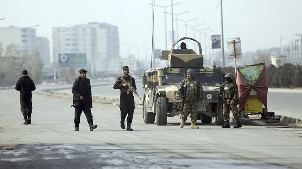 Security forces guard the site of a clash between gunmen and security forces in Kabul on Monday. Gunmen stormed a partially constructed building near an intelligence training center, triggering a gun battle with security forces as detonations and shooting reverberated from the area.