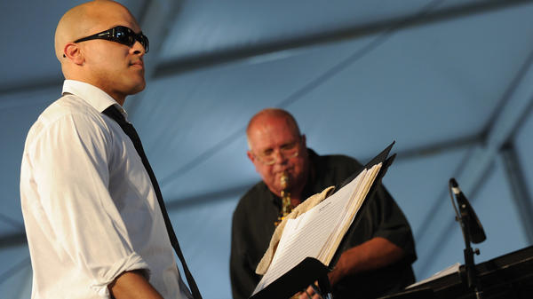 Irvin Mayfield leads the New Orleans Jazz Orchestra, featuring saxophonist Ed Petersen, during the 2012 New Orleans Jazz & Heritage Festival.