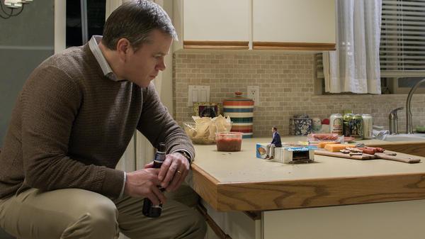 Matt Damon as Paul Safranek and Jason Sudeikis as Dave Johnson in <em>Downsizing</em> from Paramount Pictures.